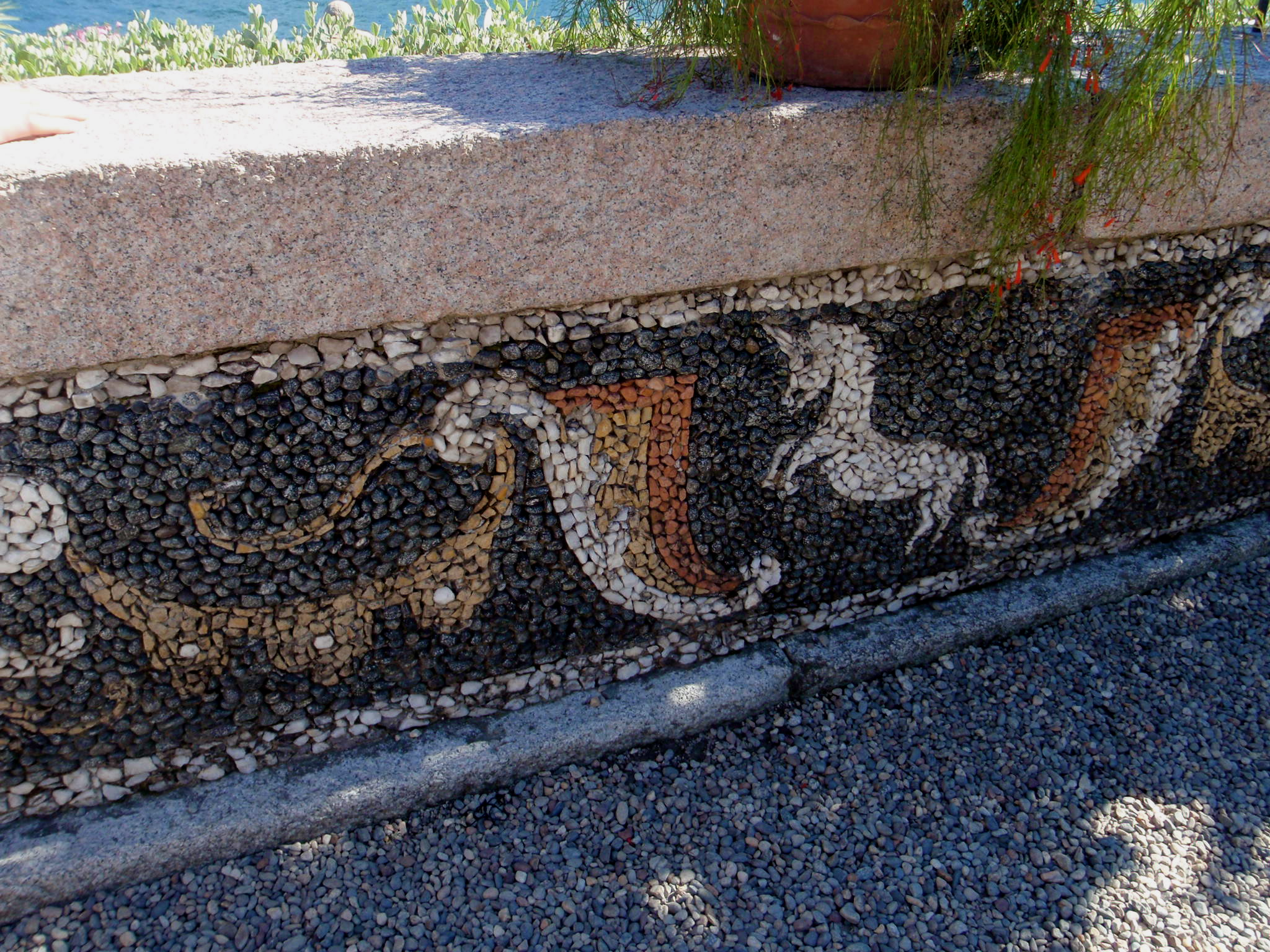 mosaic along the side walks of the garden