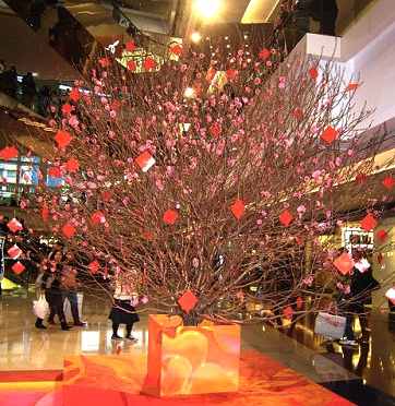 Huge peach blossom tree in display inside shopping mall