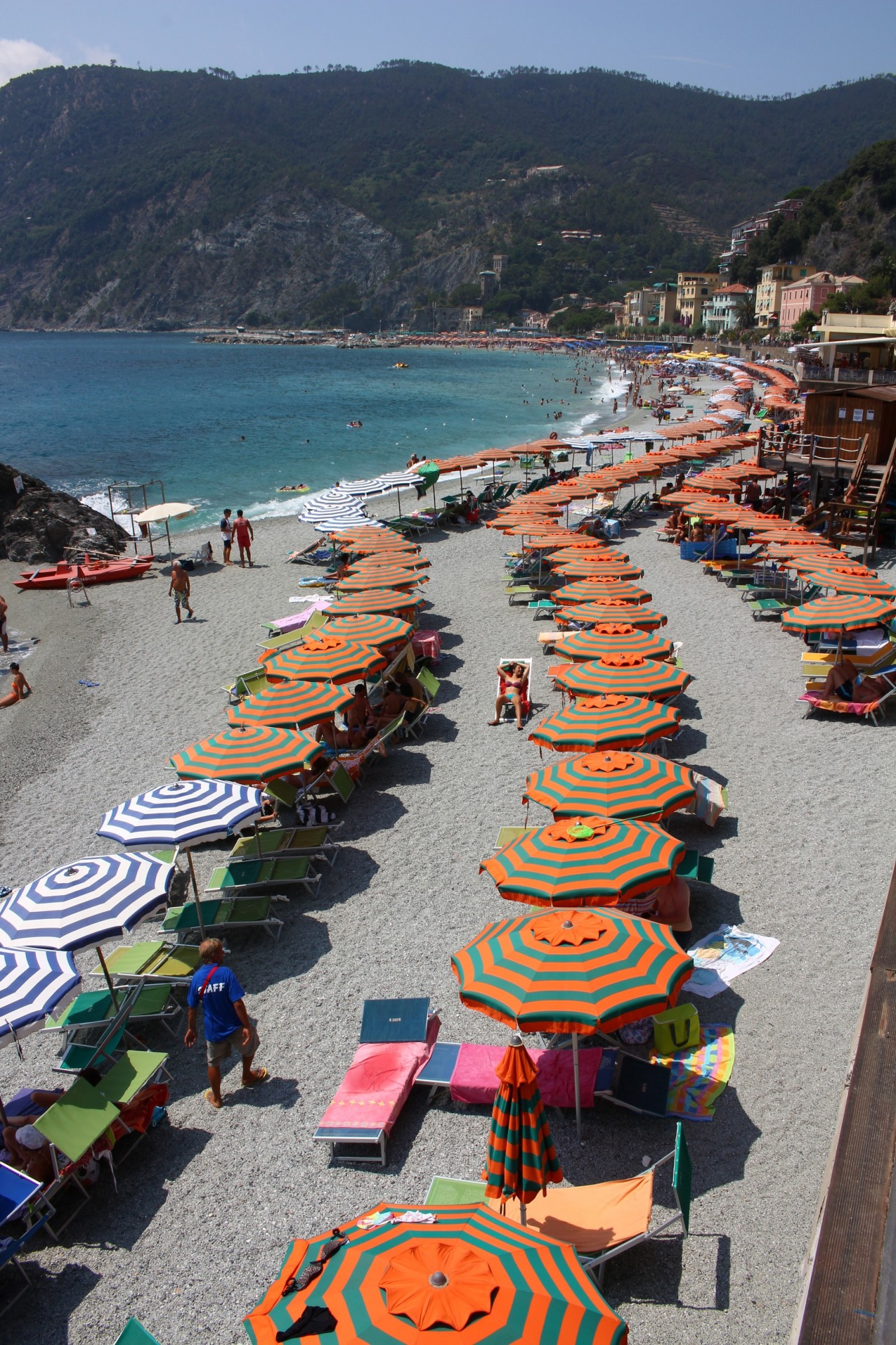 various colors of the beach umbrellas adorn the beach of Monterosso